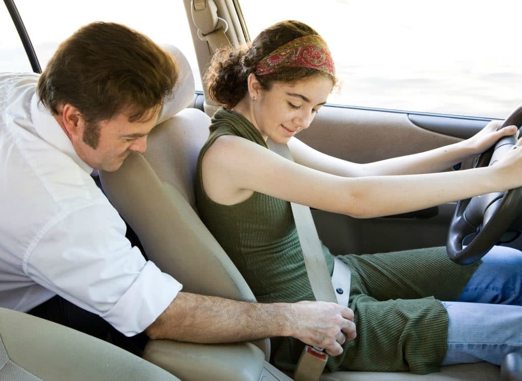 parent helping teen driver